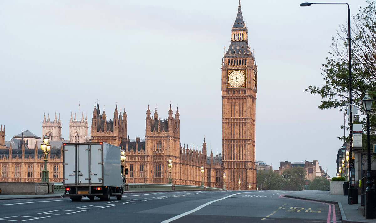 Delivery truck passing over Westminster Bridge, London